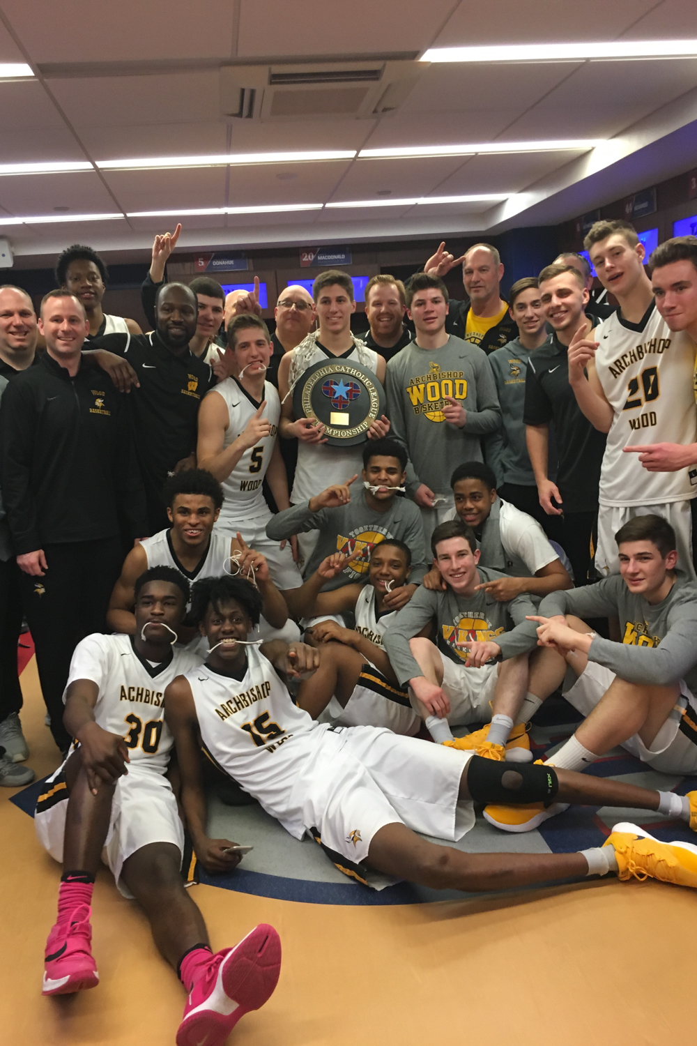 Archbishop Wood Boys Basketball Team and Coaches - 2017 PCL Champs - in the locker room at the Palestra after they won the game.