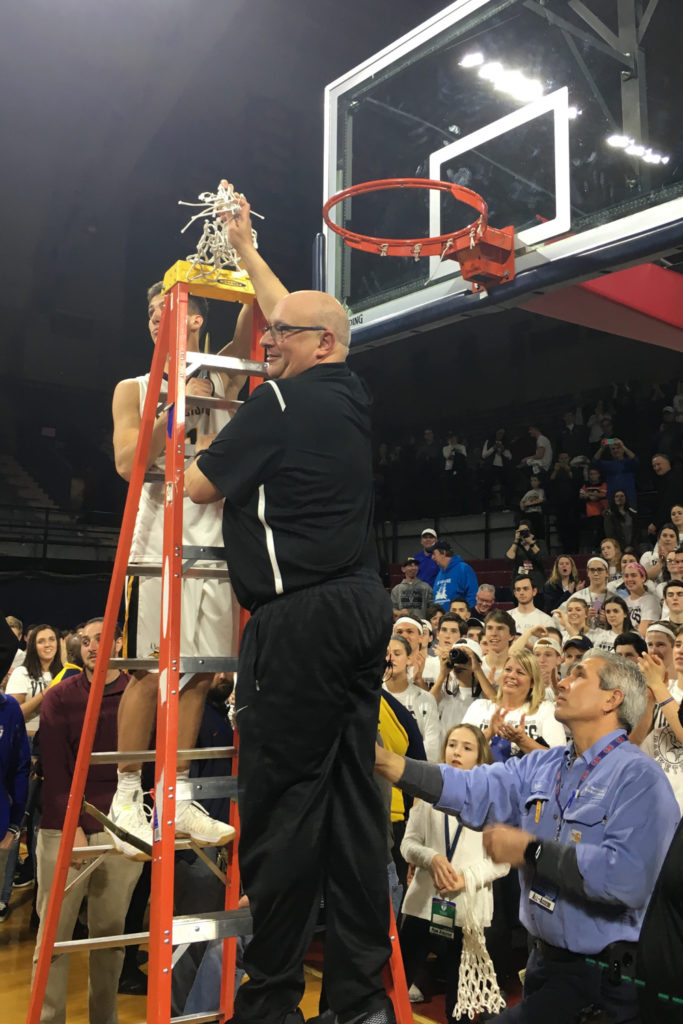 2017 Philadelphia Catholic League MVP Collin Gillespie and Coach John Mosco cutting the net at the end of the game. Coach Mosco modeled Emotional Contagion throughout the entire game. Through behavioral mimicry, Collin Gillespie picked up on Coach Mosco's emotions and was able to keep a calm demeanor throughout the game.